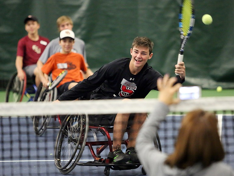 Nolan Connell, a Steamboat Springs High School student, gets to experience tennis in a wheelchair Thursday during the Wheelworks Wheelchair Tennis Training session inside The Tennis Center at Steamboat Springs.