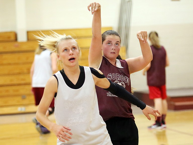 Soroco junior Morgan George, left, and sophomore Bailey Singer run through drills on Thursday during basketball practice in Oak Creek. Thursday was the first official day of high school practices for winter sports in Colorado.