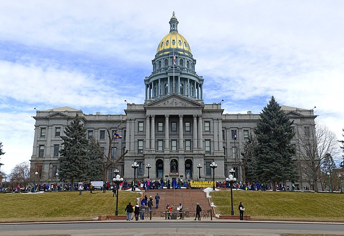 Demonstrators line the front the the Colorado State Capitol during a Colorado Right to Life march in Denver. State legislators will soon consider a bill that would extend whistleblower protections to municipal, county and school district employees.