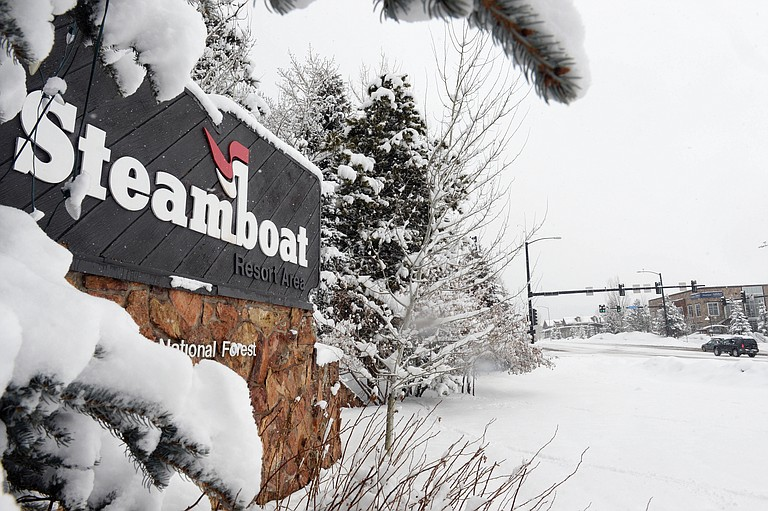 Snow stacks up on a sign at the Steamboat Ski Area.