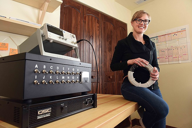 Liz Kirt, 36, uses a Doug Coil Rife machine as part of her treatment for Lyme disease.