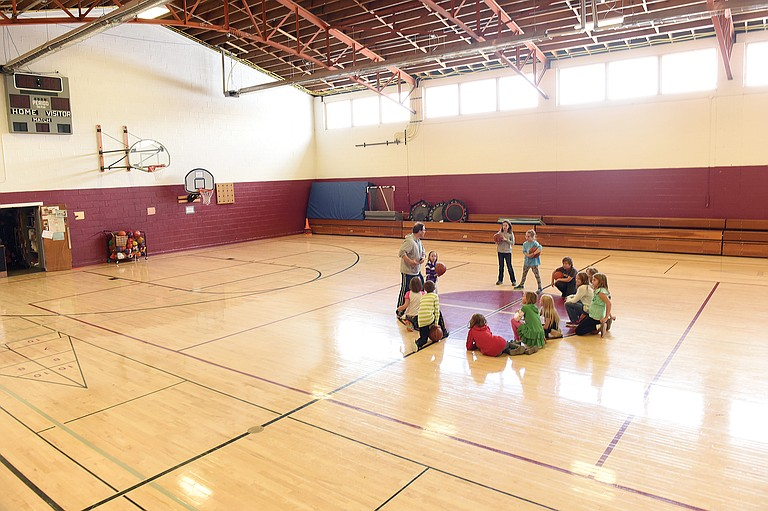Physical education teacher Artie Weber teaches the basics of basketball inside the South Routt Elementary School gymnasium in November 2015.