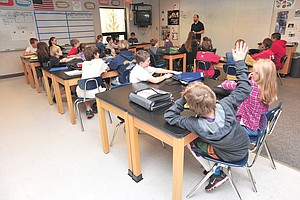 Students listen during a sixth-grade science class at Steamboat Springs Middle School in 2013.