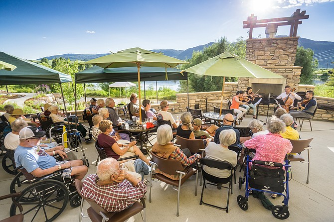 The Catalyst Quartet performs for a crowd at Casey's Pond during summer 2015.