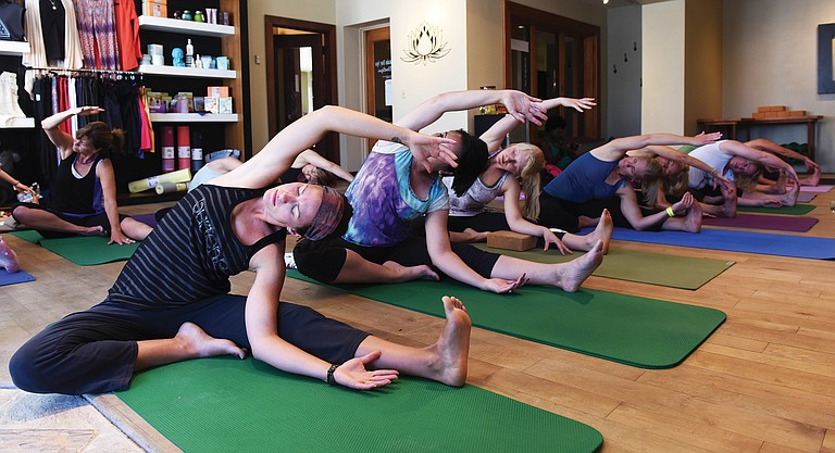 Lindsay Balgooyen takes part in a movement class at the Rocky Mountain Day Spa yoga studio at the Sheraton during the 2015 Steamboat Movement Fest.