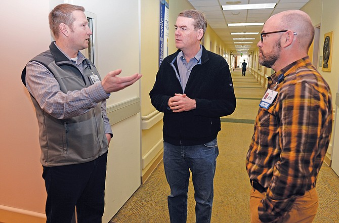 Democratic U.S. Sen. Michael Bennet visits with Chief Financial Officer Bryan Roach (left) and Chief Medical Officer Ken Lindsey while touring the Yampa Valley Medical Center in February. Bennet, who is seeking a second term, is challenged by Republican Darryl Glenn.
