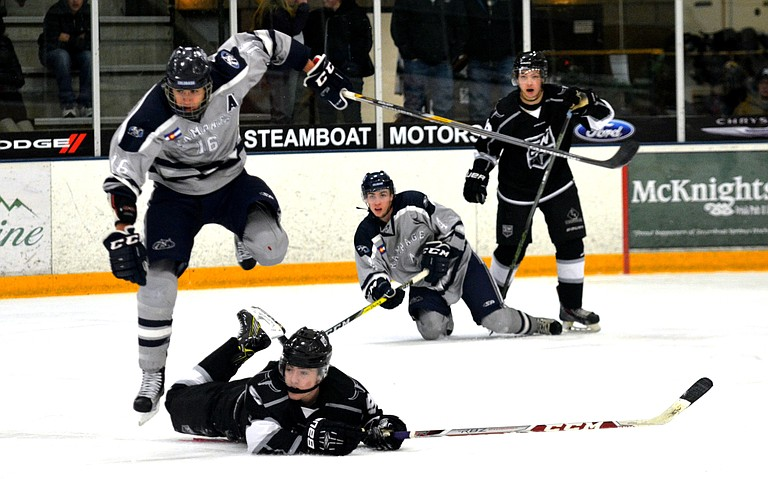 Quinny Baker dodges a defenseman for the Rampage, while keeping his eye on the puck Friday night as the Steamboat Wranglers won the game, 3-2.