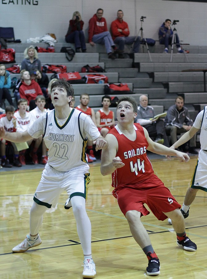 Steamboat's Charlie Harrington fights for position for a rebound while playing at the Roughrider Shootout at Roosevelt High School this weekend.