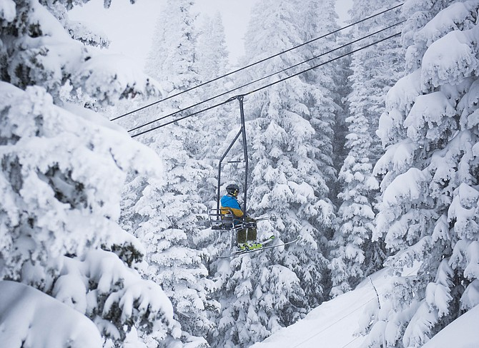 A skier rides up Bar UE chairlift at Steamboat Ski Area.