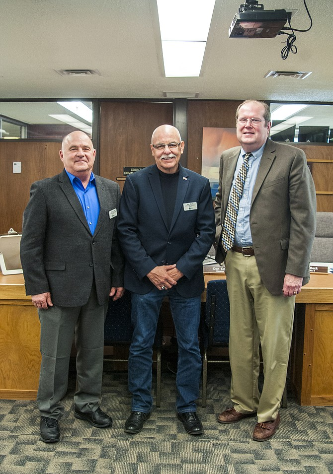 The Moffat County Board of Commissioners welcomed two newly elected commissioners Tuesday, Don Cook, left, and Ray Beck, center. Frank Moe, right, has served on the board for two years. Commissioners will face tough decisions in the coming years as they seek to balance the budget amidst declining revenues from natural resources.