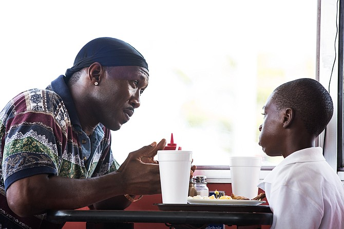 "Juan (Mahershala Ali) advises Chiron (Alex Hibbert) in ""Moonlight."" The movie won multiple awards from Denver Film Critics Society, including Best Picture, Best Director, Best Adapted Screenplay and Best Supporting Actor."