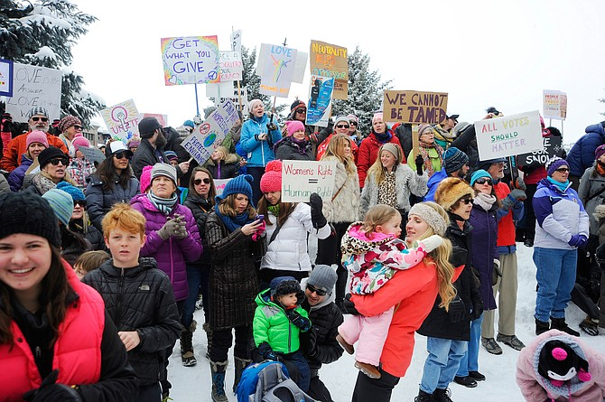 Women's March on Steamboat Springs participants hold signs during a rally Saturday at the Routt County Courthouse.