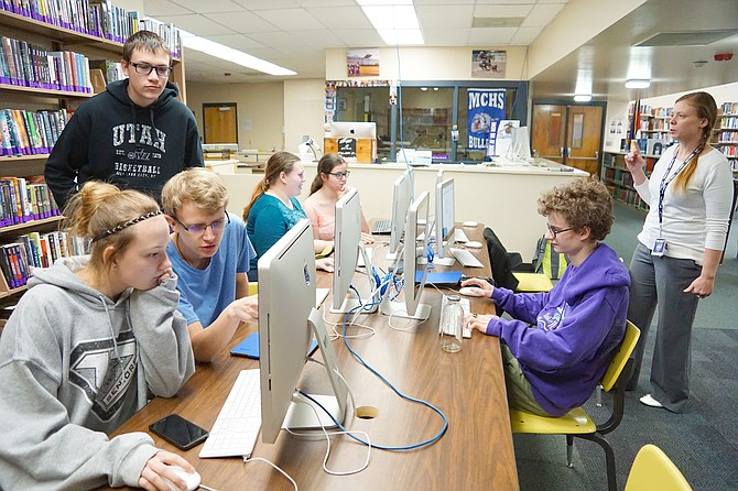 Research plays a big part in Moffat County speech and debate team members' preparation for competition. Coach Stephanie Everett, right, keeps the team on task. Seated on the right is Jeremy Looper. Also pictured, from left, are Katie Currie, Evan Cramer-Wagner, Gage Rowley, Jessica Johnson and McKenzie Aguirre. Not pictured are team members Nikki Currie and Jacob Briggs.