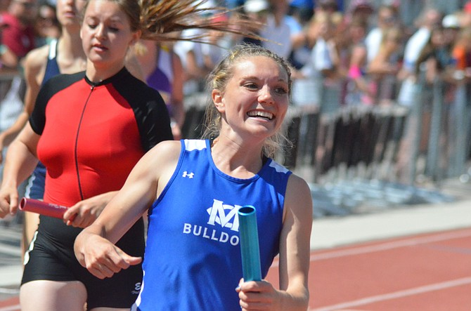 Kayla Pinnt grins from ear to ear after winning the 2016 state championship in the 4x100-meter relay. The former Moffat County High School runner was named Sportswomen of Colorado's All-Around Athlete for small schools and will be honored in March by the organization, which acknowledges female athletes in the state, from THE high school to Olympic level.