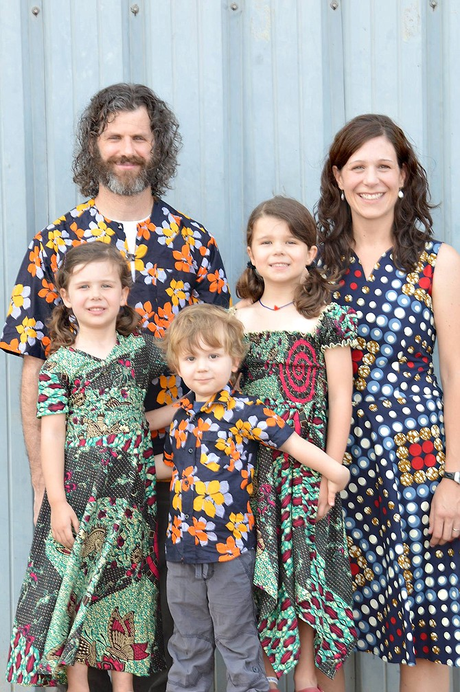 New Moffat County School District Director of Finance John Wall and his family spent about five years working aboard the hospital ship African Mercy. Pictured wearing African garb, Wall stands next to his wife Tracey Wall and behind their three children — Cora, 4; Jack, 3; and Adalynn, 6.