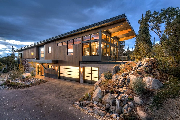This contemporary home, recently completed by Soda Mountain Construction, features a one-twelfth pitched shed roof to simplify the design, and exterior finishes include clear, vertical-grain siding, board-formed concrete and hot-rolled steel.