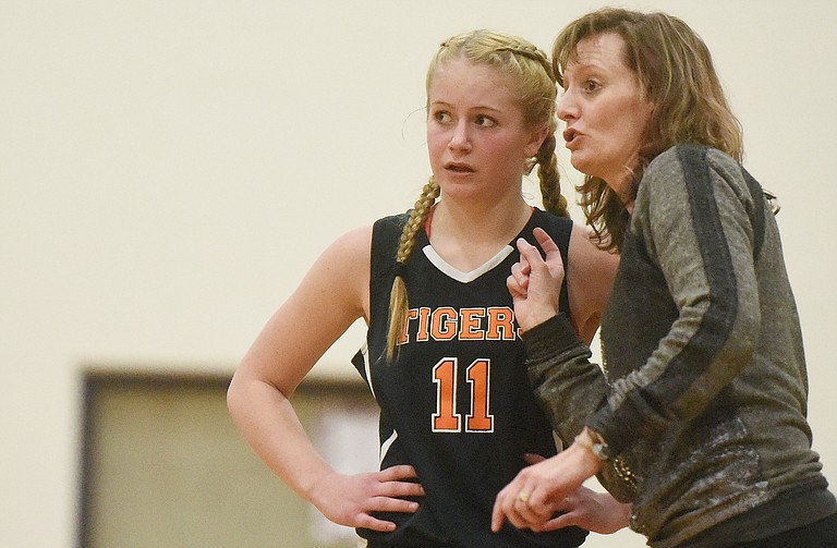 Hayden coach Michelle Wilkie talks to sophomore Allison Ingols during a game earlier this month. The Tigers won at home on Saturday, beating Plateau Valley.