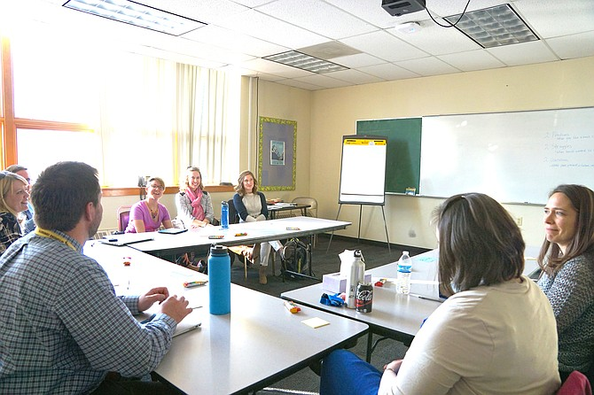 Teachers and staff of Moffat County School District meet Monday to discuss strategies for more effective teaching.