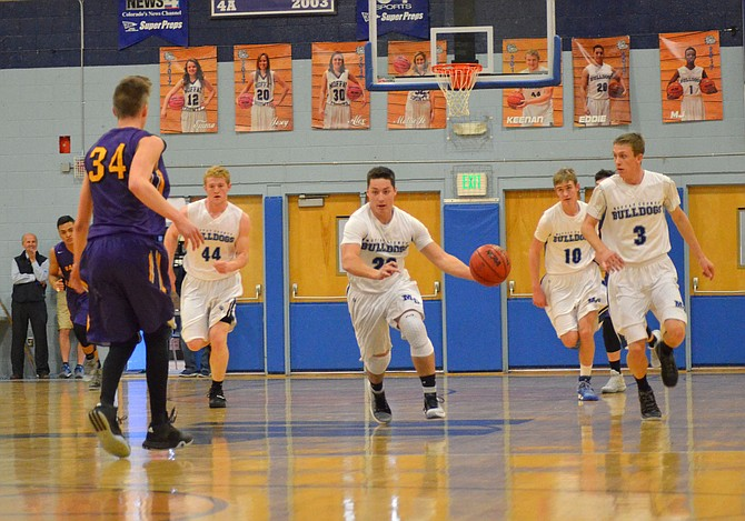 Moffat County High School's Eddie Smercina leads the charge down court during the Bulldog boys basketball game against Basalt. MCHS teams will host their final home games of the regular season Friday, which includes recognition of senior team members, pictured on the back wall.