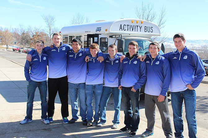 Moffat County High School wrestlers ready to board the bus Wednesday to head to Denver and the 3A CHSAA State Championships. From left, Daniel Caddy, Miki Klimper, Hugo Hernandez, Chris Moschetti, Karson Cox, Drake Zimmerman, Elias Peroulis and Toryn Hume will compete at the three-day event.