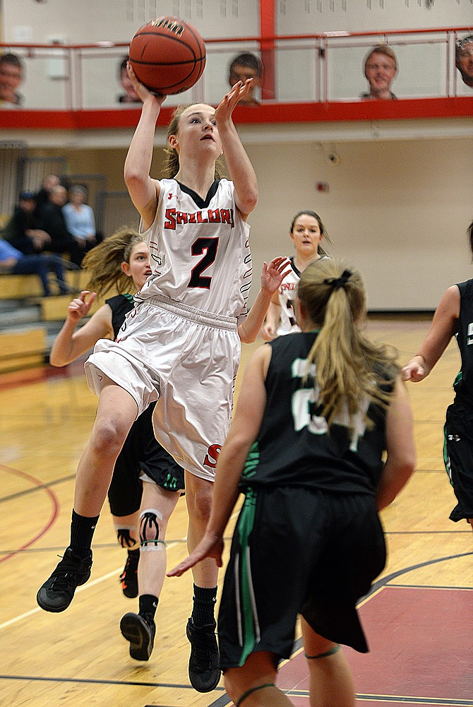 Raya Duryea takes a shot in the first half of Steamboat's loss to Summit on Thursday night.