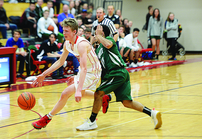 Steamboat Springs Mac Riniker drives past a Summit defender in the fourth quarter of Thursday night's game in Steamboat Springs. Steamboat won the game and has at least a share of the Western Slope League title.