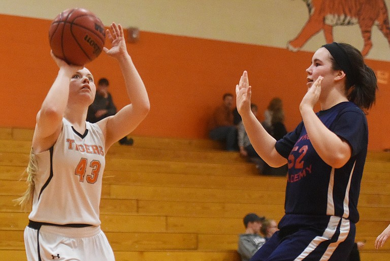 Hayden senior Jessika Hockett pulls up for a shot on Monday as the Tigers ran over Caprock Academy in the first round of the district tournament. Hayden's back in action on Wednesday, when it will travel to play Soroco.