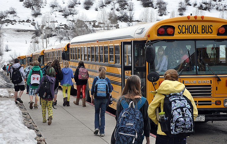 Students board a long line of busses at Steamboat Springs Middle School in 2013.