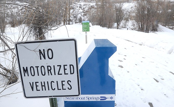 A sign at the entrance of the Yampa River Core Trail warns that no motorized vehicles are allowed. The Steamboat Springs Parks and Recreation Commission has endorsed a proposal to allow e-bikes on the Core Trail during a pilot program.