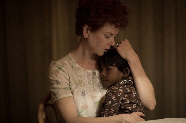 "Saroo (Sunny Pawar) bonds with his adoptive mother, Sue (Nicole Kidman), in ""Lion."" The movie is about an Indian boy who gets separated from his older brother and eventually gets adopted, later searching for details of his past as an adult."