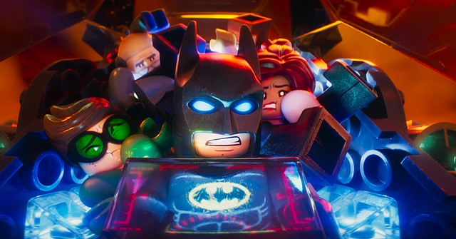 """Batman (voice of Will Arnett) tries to cram too many allies into the Batmobile in """"The Lego Batman Movie."""" The movie is a spin-off of """"The Lego Movie"""" focusing on the adventures of the Caped Crusader."""