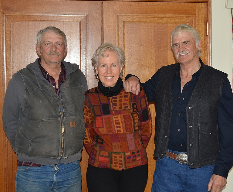 "Executive Director of the Yampa Valley Land Trust Susan Dorsey has been collaborating with brothers Dean (left) and Jim Rossi on the gradual conservation of their family cattle ranch in South Routt County since 1996. On Feb. 28 they received the approval of the Routt County Board of Commissioners for the latest 840-acre easement on a parcel named for a rocky mesa called the ""Devil's Grave."""