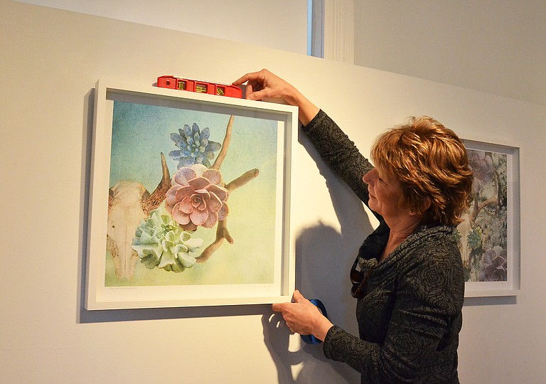 """""""Beyond Photography"""" art show chairwoman Karen Desjardin fine tunes the placement of a photographic image by artist Paula Jaconetta in preparation for the """"Beyond Photography"""" show opening 5 p.m. Friday at the Depot Art Center on 13th Street in Steamboat Springs."""
