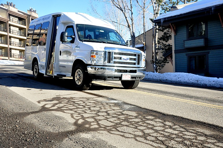 A lodging shuttle drives Thursday on a portion of Après SKi Way that has been rated to be in poor condition by a recent study of the city's road system.