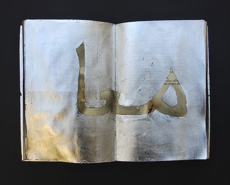 "Book artist Janet Bradley said this piece of her book art means ""together"" in Arabic."