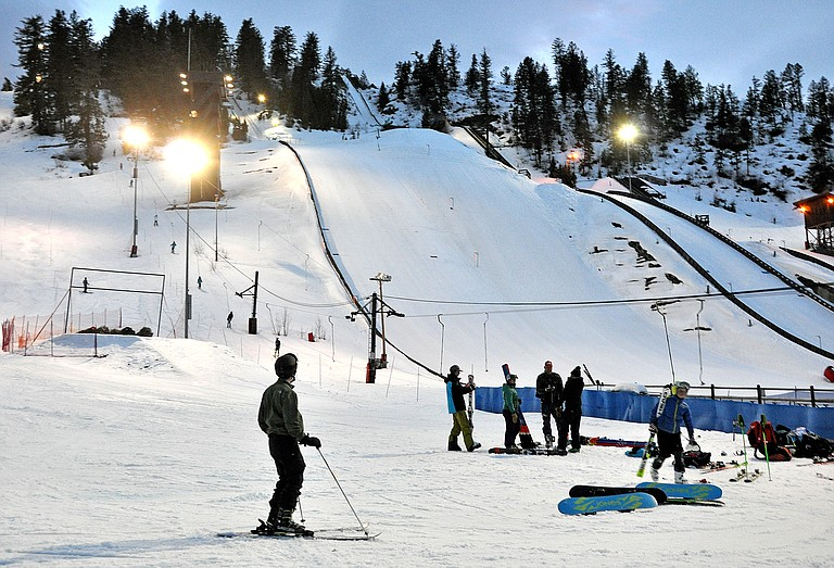 Steven Moca watches skiers make some jumps on Howelsen Hill Wednesday evening. Moca, who was visiting Steamboat with his family from North Carolina, called the ski area a fun, beautiful place.