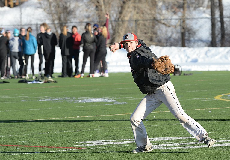 Freshman Ethan Hansen looks to throw the ball while working through a drill at the Stemaboat Springs High School Athletic Field Tuesday afternoon. The baseball team was sharing the field with the girls lacrosse team, which can be seen in the background.