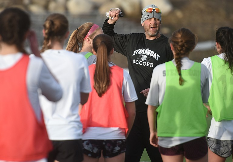 Steamboat coach Rob Bohlmann speaks to his team Wednesday during a practice at Steamboat Springs High School. The team will attempt to defend the Western Slope championship.