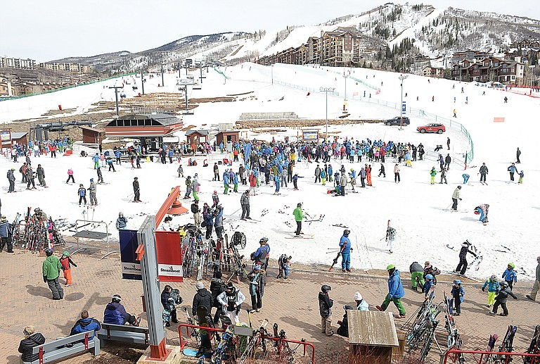 Skiers and snowboarders congregate Monday at the base of  Steamboat Ski Area. A 40-percent increase in the cost of seniors ski passes during the past two years has some older skiers upset.