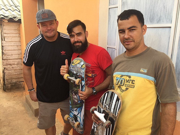 Marco Cuevas, left, and two residents from Bolondron, Cuba, who enjoyed trying out skateboarding for the first time.
