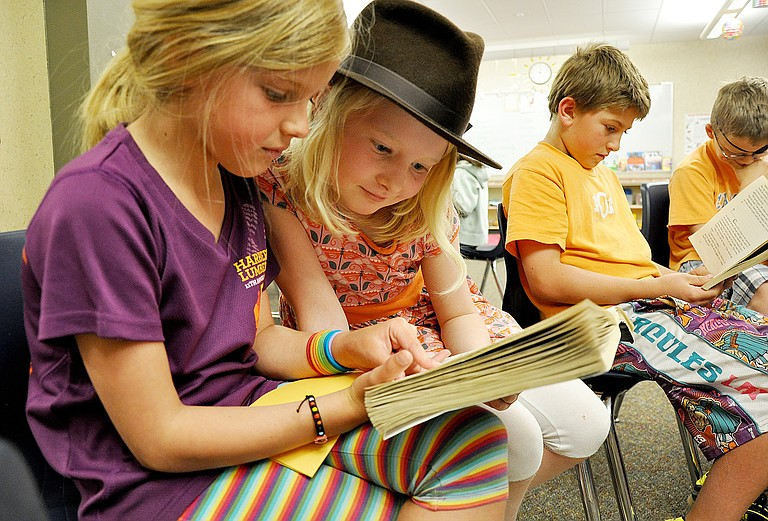 A group of third-graders read during class at Soda Creek Elementary in 2013.