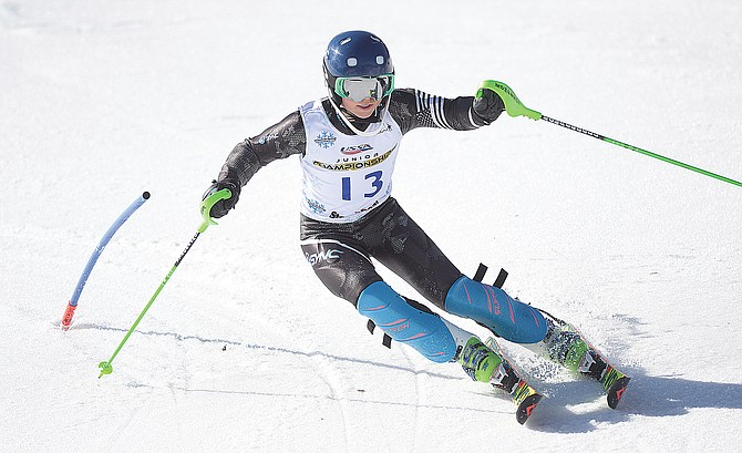 Steamboat Springs ski racer Jordan Simon clears a gates near the bottom of the slalom course during Monday's USSA Rocky Mountain/Central U14 Alpine Skiing Championships at Howelsen Hill.