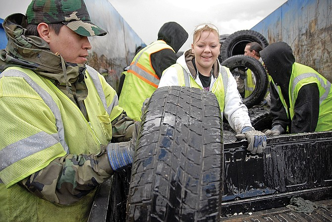 Ike Reedy, left, of Hayden, and Nikki Granados, of Craig, dispose of used tires during the 2011 Craig Cleanup Days.City, county and business leaders are preparing for a bigger, better community cleanup in the spring, and volunteers are needed.