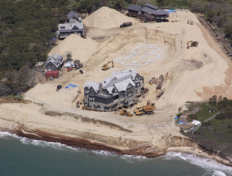 The owners of this more than 8,000-square-foot summer home, complete with a bowling lane and movie theater, located on the east end of Martha's Vineyard, moved the home back 250 feet from the ocean.