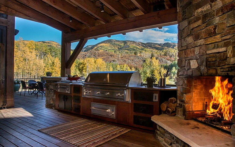 The outdoor kitchen at the Welch home on Bucks Path offers fresh air and mountain views.
