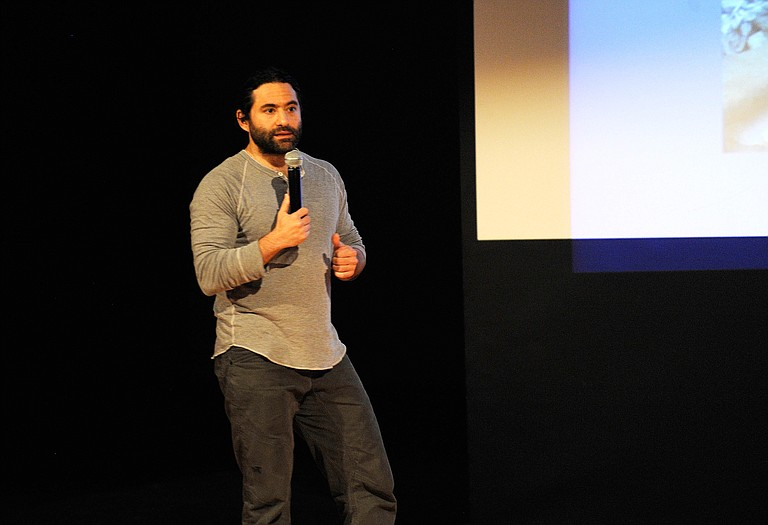Dr. Samer Attar speaks to Steamboat Springs High School juniors Friday about his time volunteering as an orthopedic surgeon in Syria.