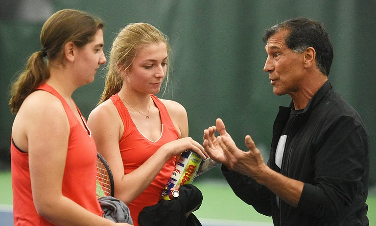 Steamboat coach John Aragon talks with No. 1 doubles team players Emmie Thompson, left, and Natalie Simon. The pair lost a grueling match Friday night against Ralston Valley, but came back to win an equally grinding match on Saturday against Fruita Monument.