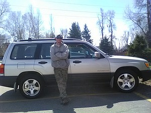 Jessie Partlow stands in front of the 2001 Subaru Forester he received because of a grant from the WZ Giving Circle awarded to the Fatherhood Program of Routt County.