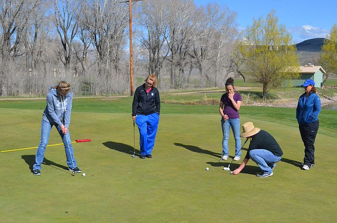 The Moffat County High School girls golf team hones their putting skills on Yampa Valley Golf Course's first green as they work their way around the front nine Wednesday. MCHS girls most recently competed at Rifle Creek and will travel to Gypsum April 25, followed by a home event May 1.