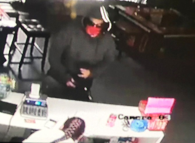 The Mesa County Sheriff's Office is asking for the public's help in identifying the suspect, pictured here from surveillance camera footage, who robbed a Grand Junction business at gunpoint shortly after midnight Thursday morning.